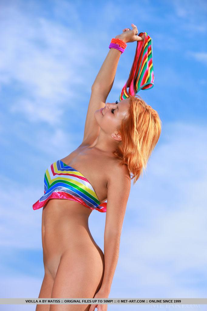 Cute Redhead Babe Violla A on the Beach